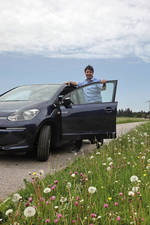 Christian Schneider with the new electric vehicle, the VW e-up
