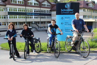 Schneider employees with their new E-Bikes